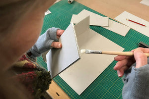 glueing corner edges to make a portfolio box in a traditional box making way