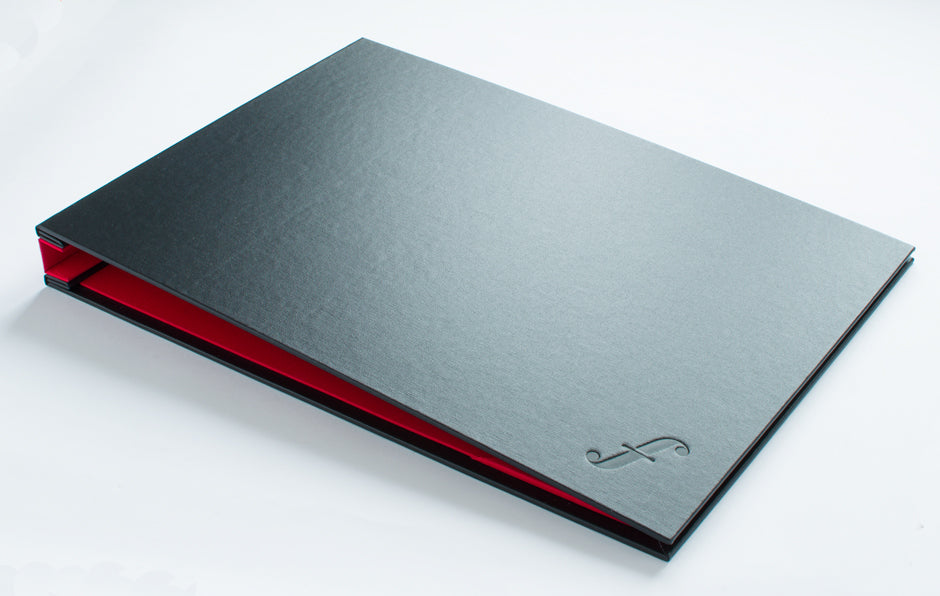 A3 Graphic designers portfolio in Black buckram and Alton red book cloth with blind deboss personalisation