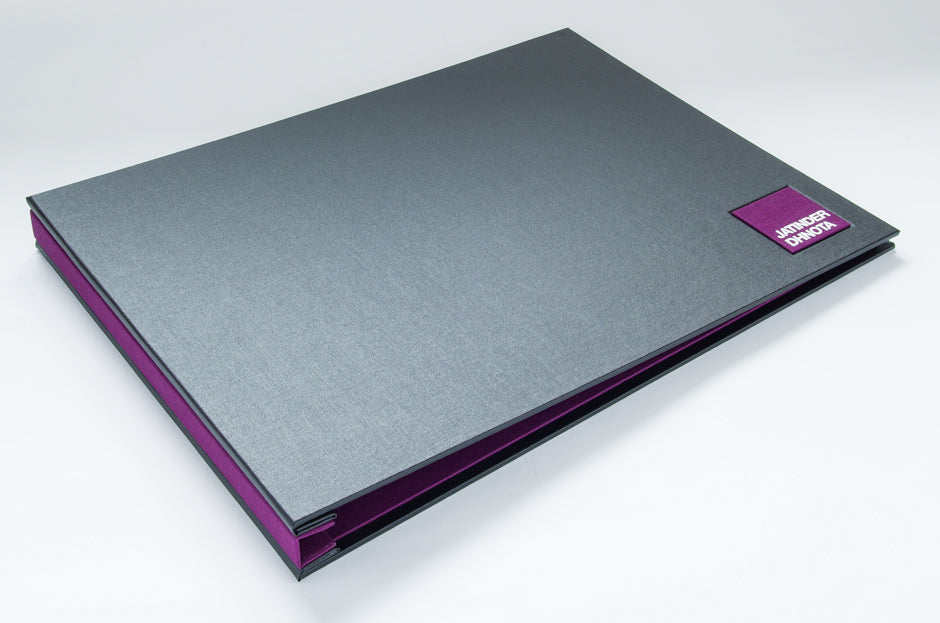 A3 landscape portfolio in Charcoal buckram and Harlech purple book cloth with square name plaque