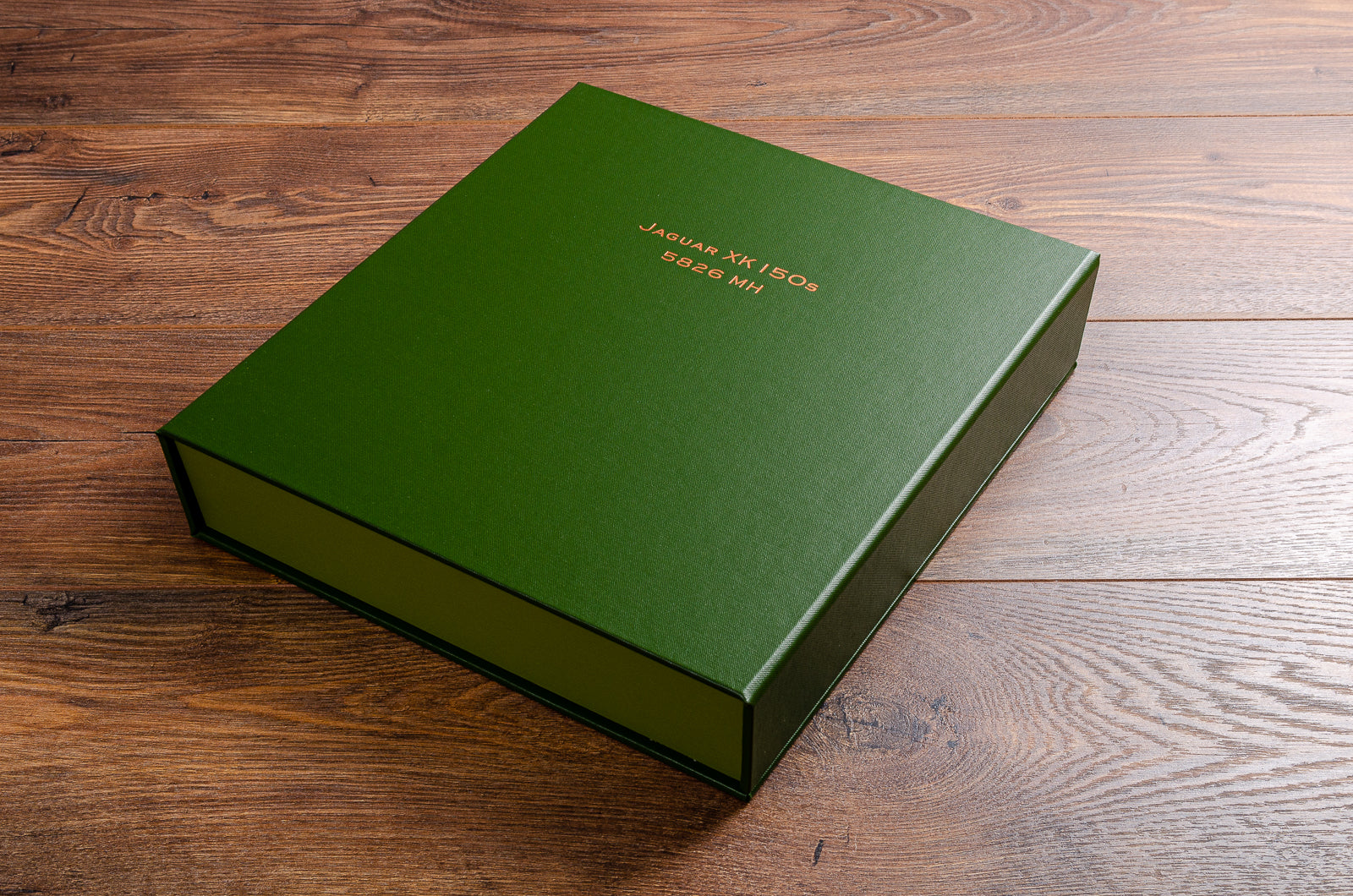 Vehicle document box file in Racing Green buckram with copper foiled embossing for Jaguar XK150s