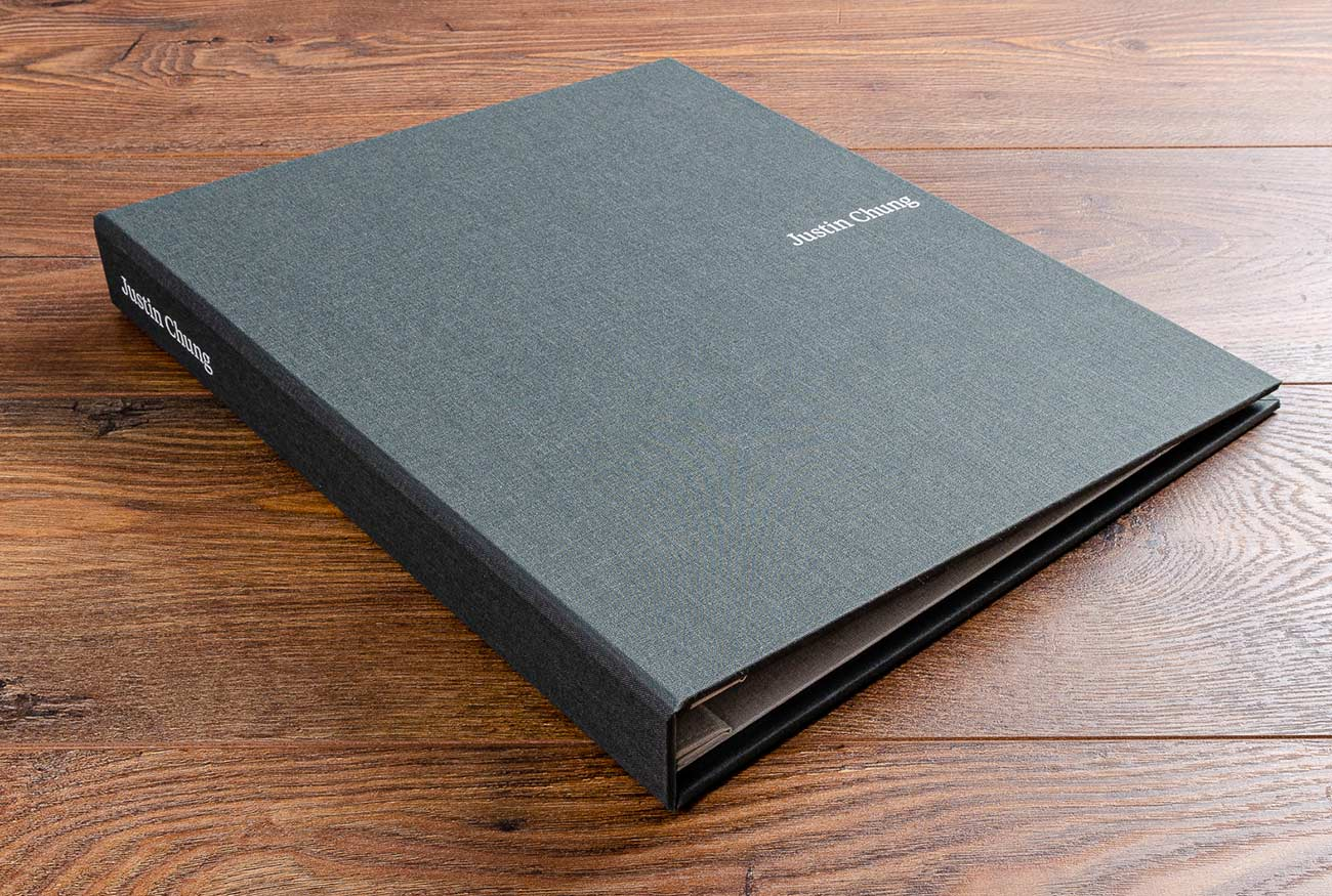 Portrait case bound portfolio book with white foil personalisation on cover and spine.