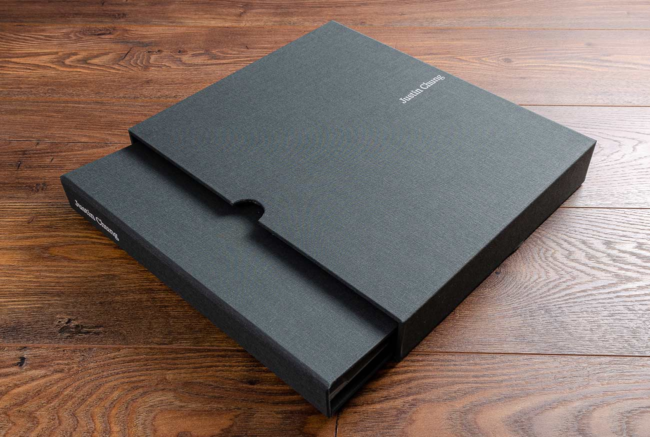 Photographers 11x14 casebound portfolio book and matching slipcase with white foil personalisation