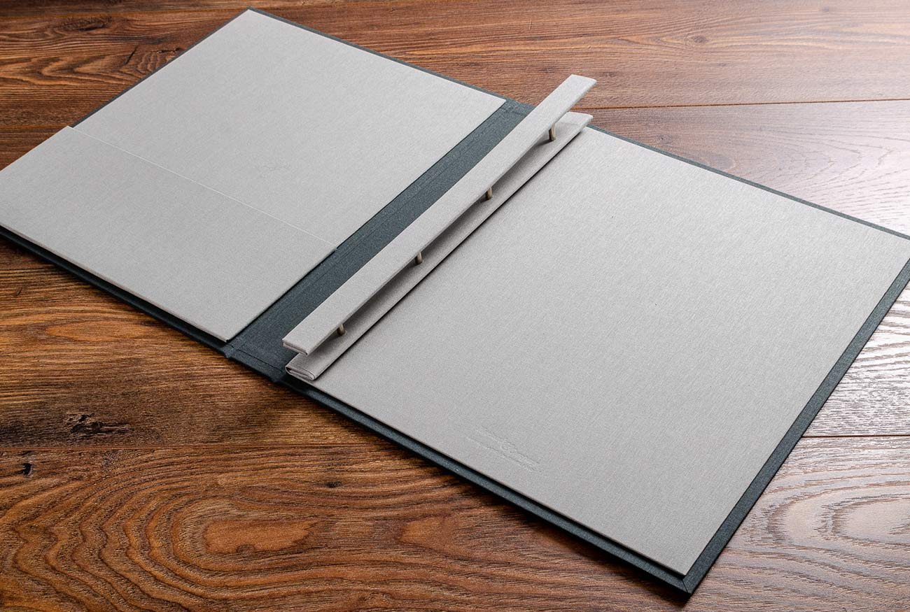 Inside covers of the photographers portfolio has a screw post binding mechanism and is in Stone book cloth