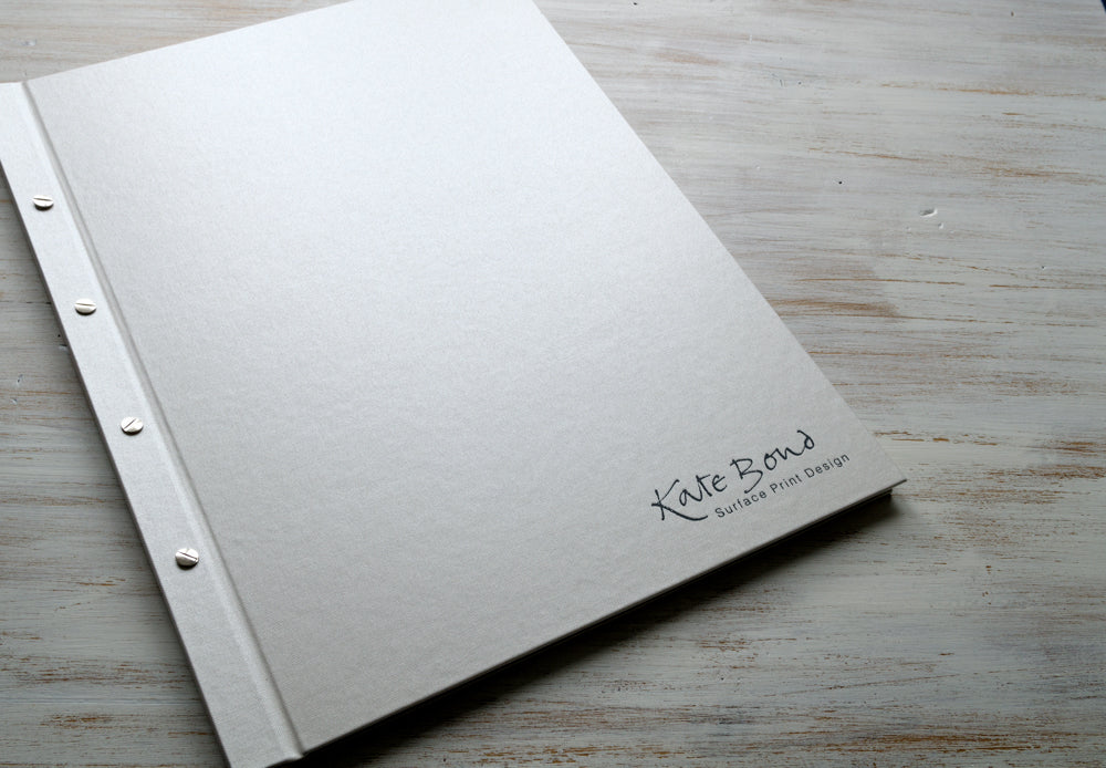 A2 portrait portfolio book in Ivory buckram with black foil personalisation
