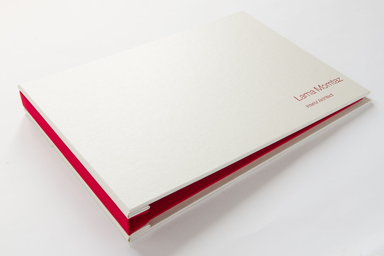 A4 landscape hidden screw post portfolio book for Interior architect student - Pearl buckram outer cover and alton red inner cover