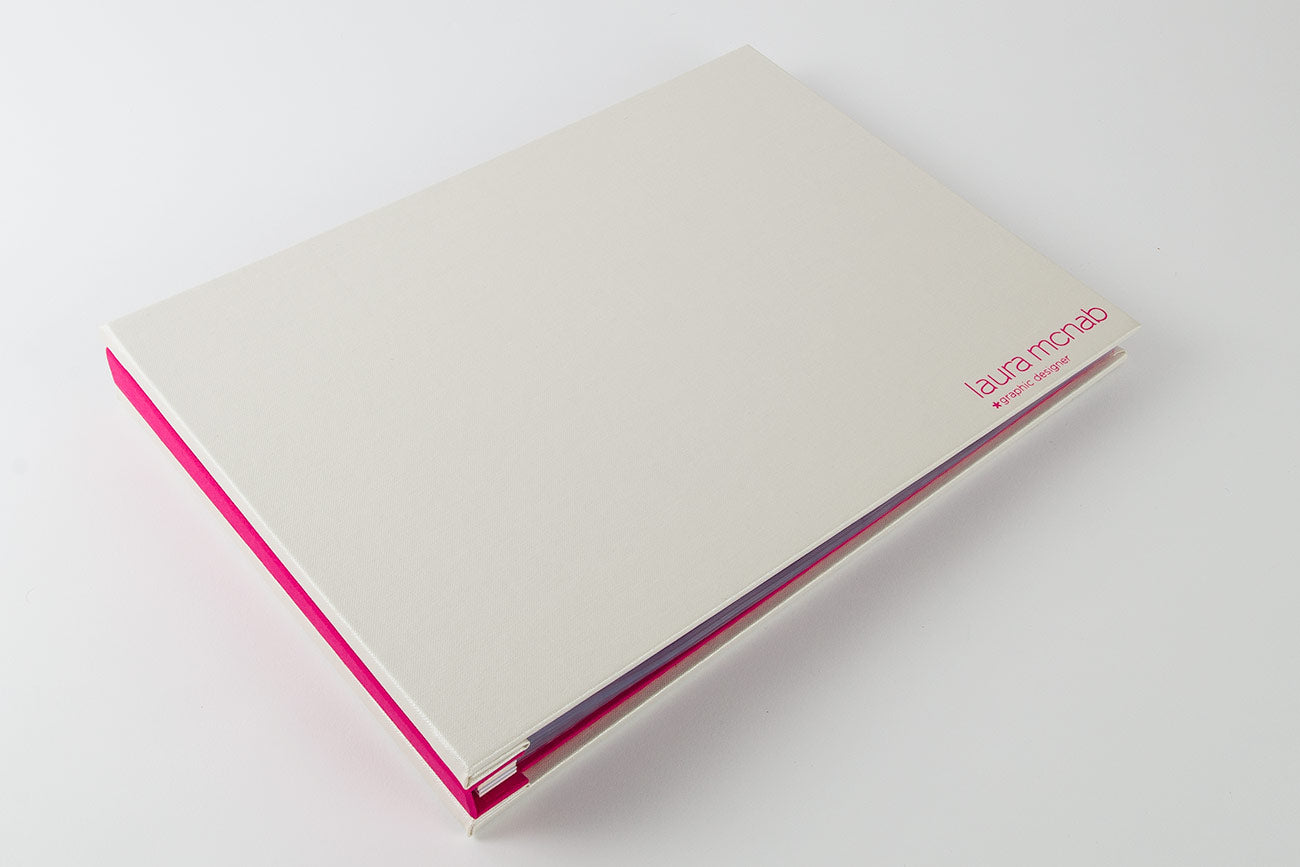 A4 landscape graphic designers custom portfolio book - Pearl buckram, pink foil personalisation and exe pink inner cover and spine cover