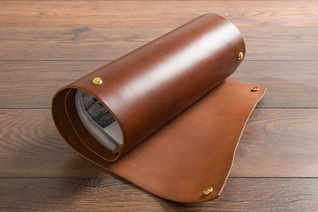 brown leather scroll with metal popper fastenings