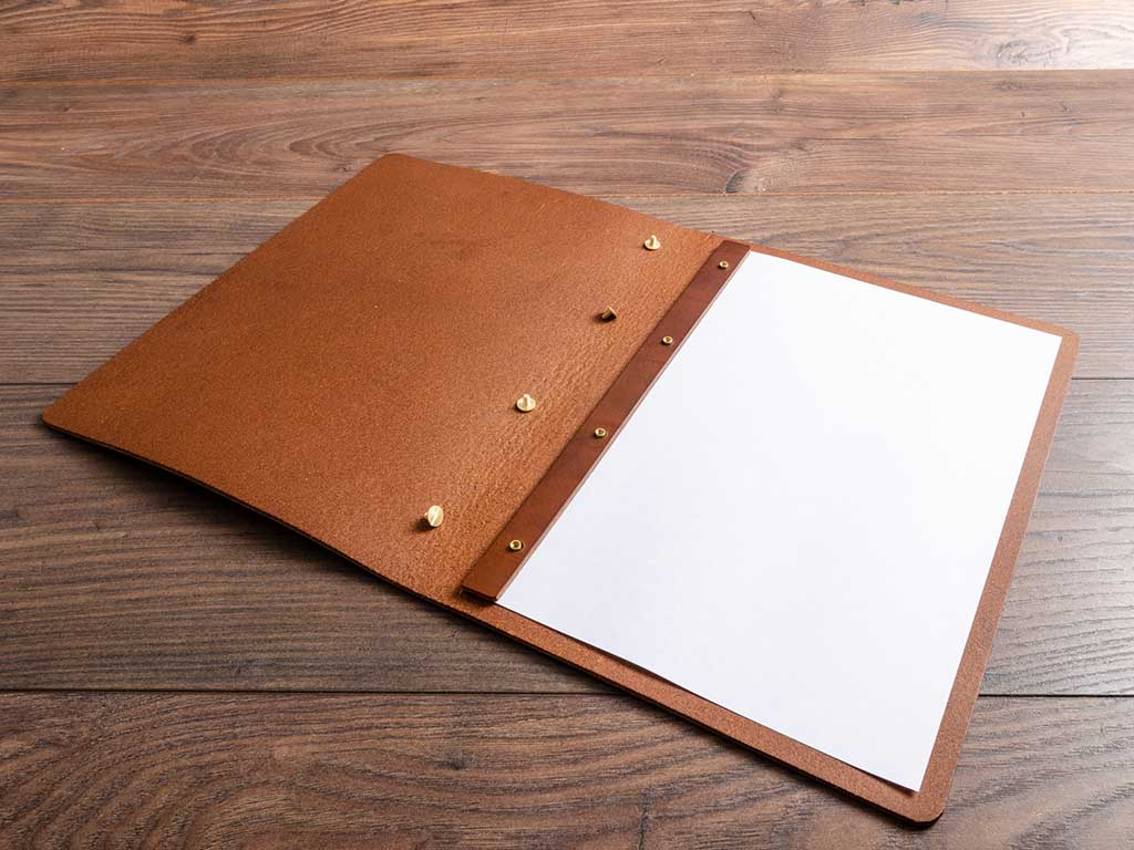 custom made brown leather menu with page inserted with screw posts by hartnack