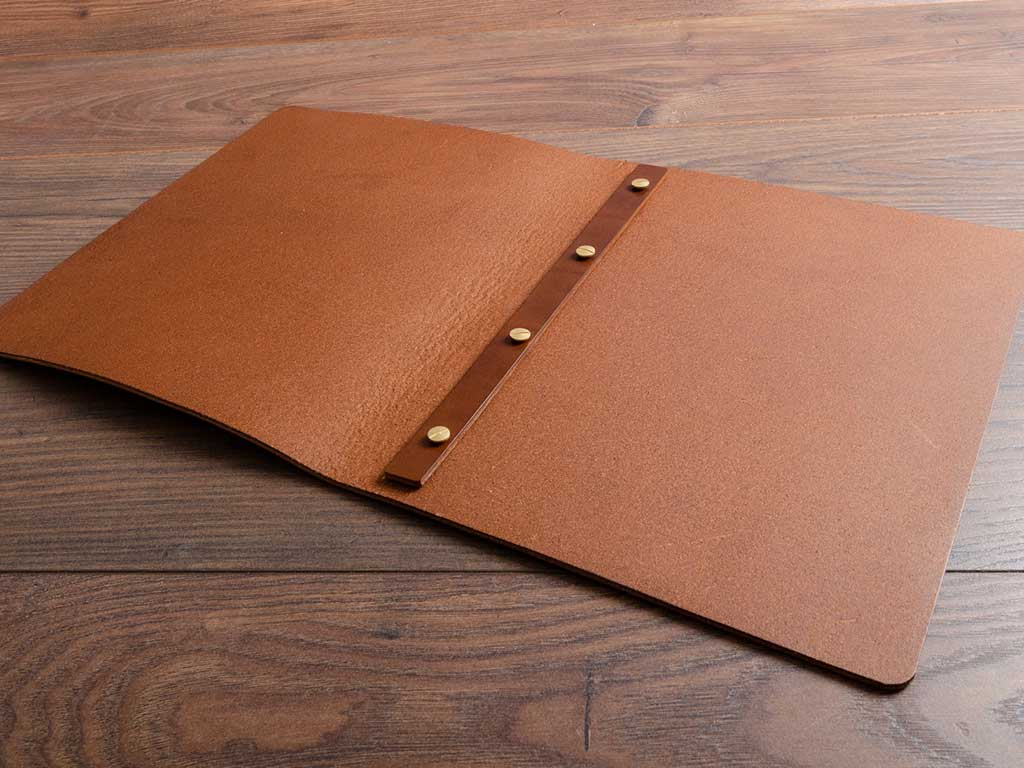 brown a4 leather menu open with no pages handmade by hartnack