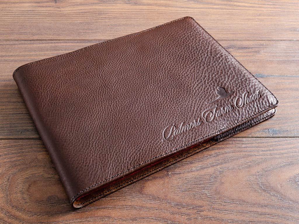 Hand stitched leather book cover with blind debossed personalisation for very old hard back guest book
