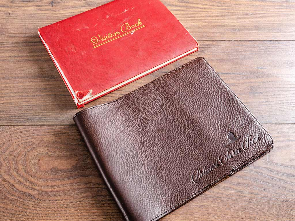 Leather dust jacket cover (below) for very old farm guest book (above).