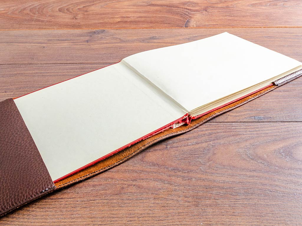 Original book slips into the leather book cover with ease - Note the hand stitched detailing