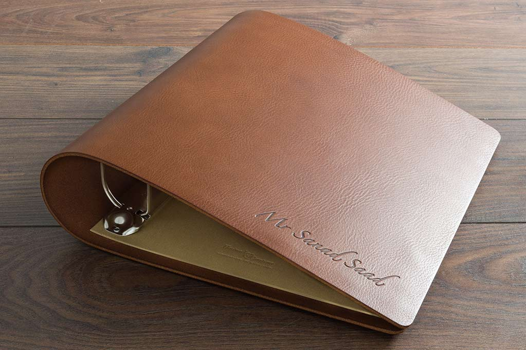 A4 portrait 3.5mm brown leather ring binder with blind debossed personalisation