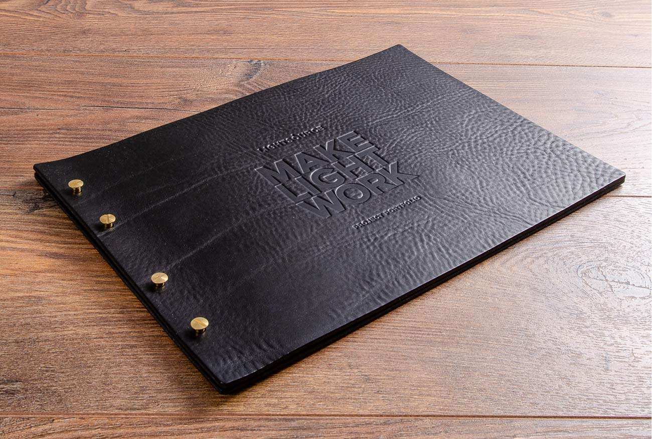 A4 black leather exposed screw post portfolio book with blind embossed personalisation
