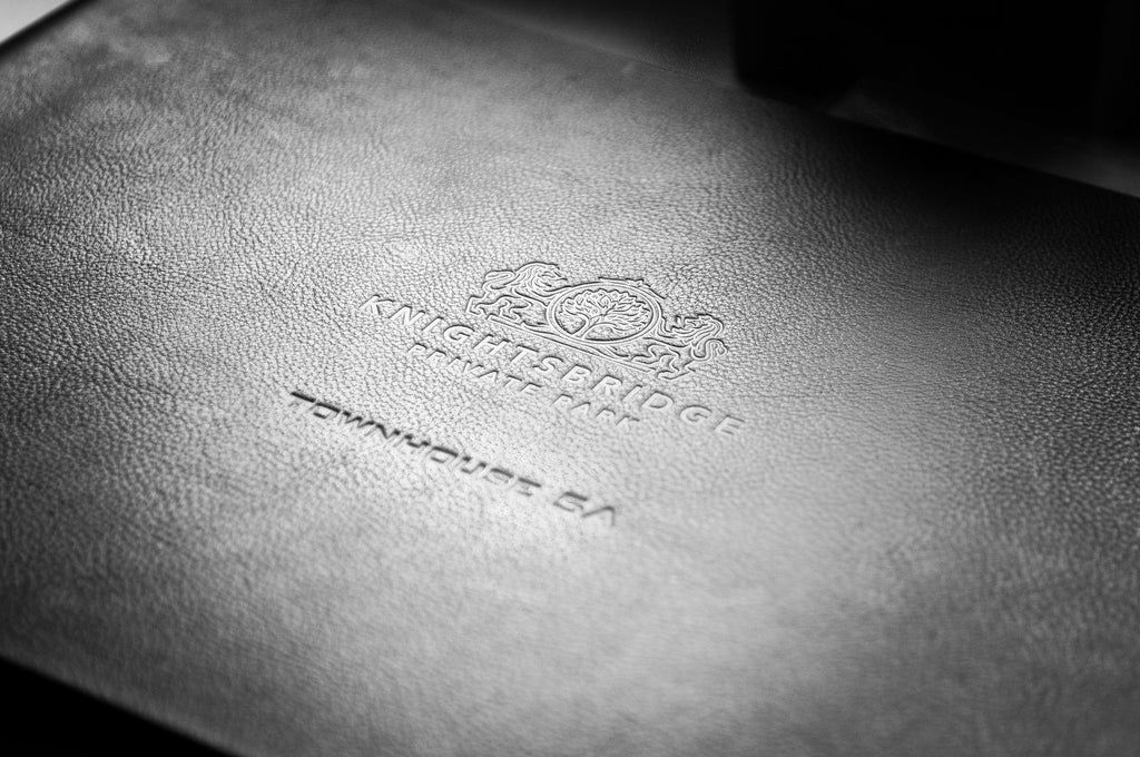 Blind Embossing of Logo on Hartnack and Co Black Leather Presentation Binder