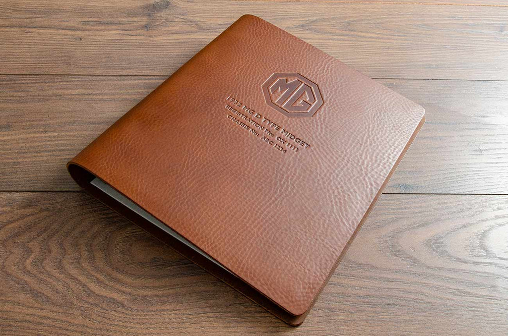 3.5mm brown leather MG car document folder with blind debossed logo and vehicle details