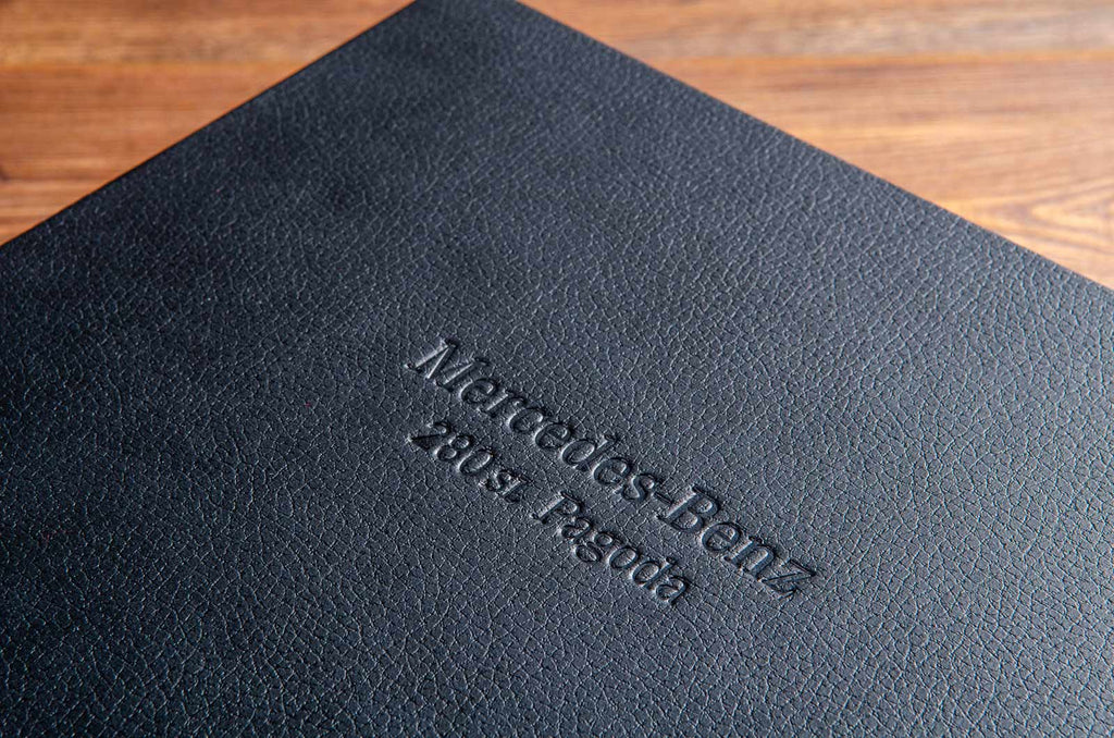 Blind debossed personalised cover of a car document box with the words Mercedes Benz 280sl