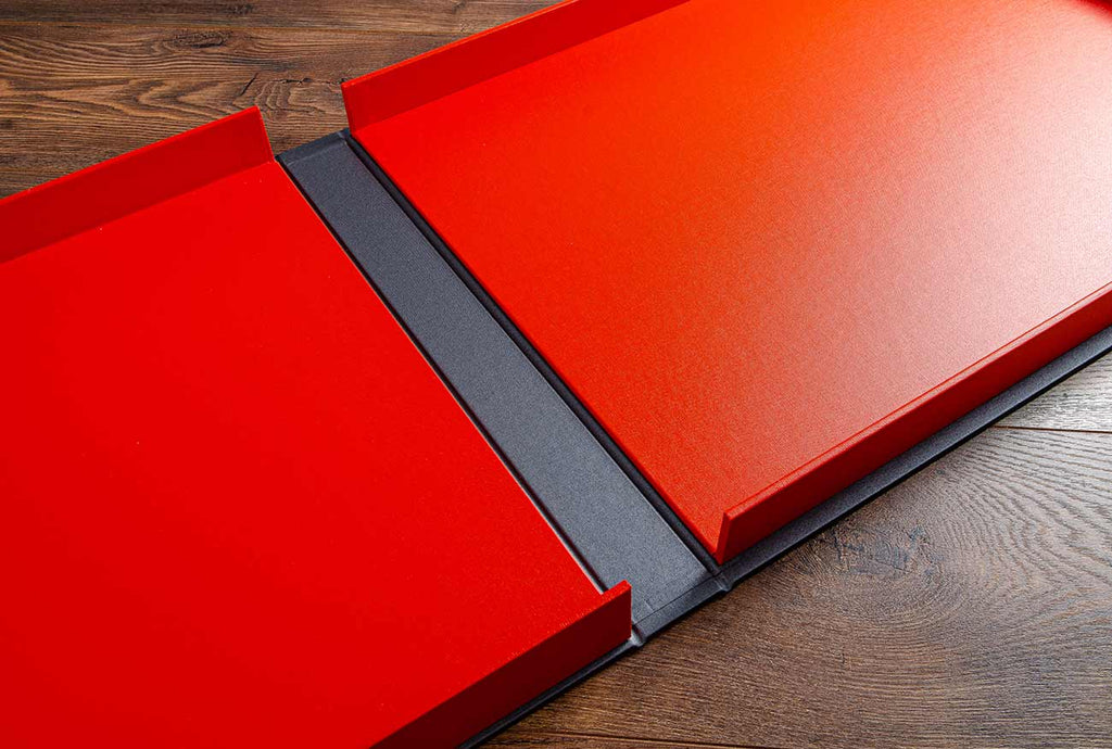A3 landscape portfolio box with tangerine orange buckram inner trays