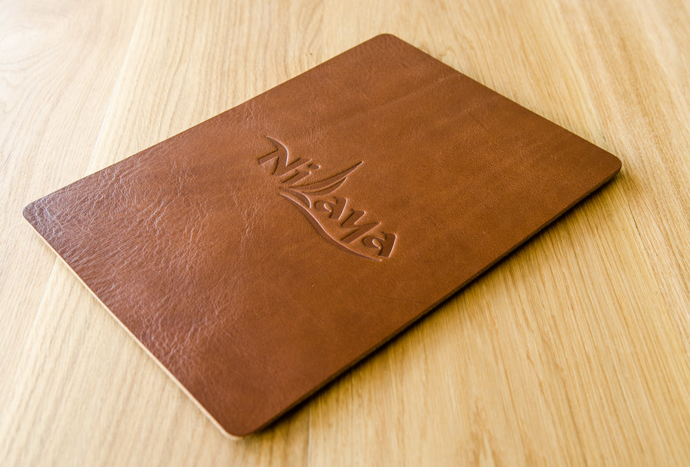 A5 leather single sheet menu and wine list for MY Nilaya with blind debossed stamping of yacht logo