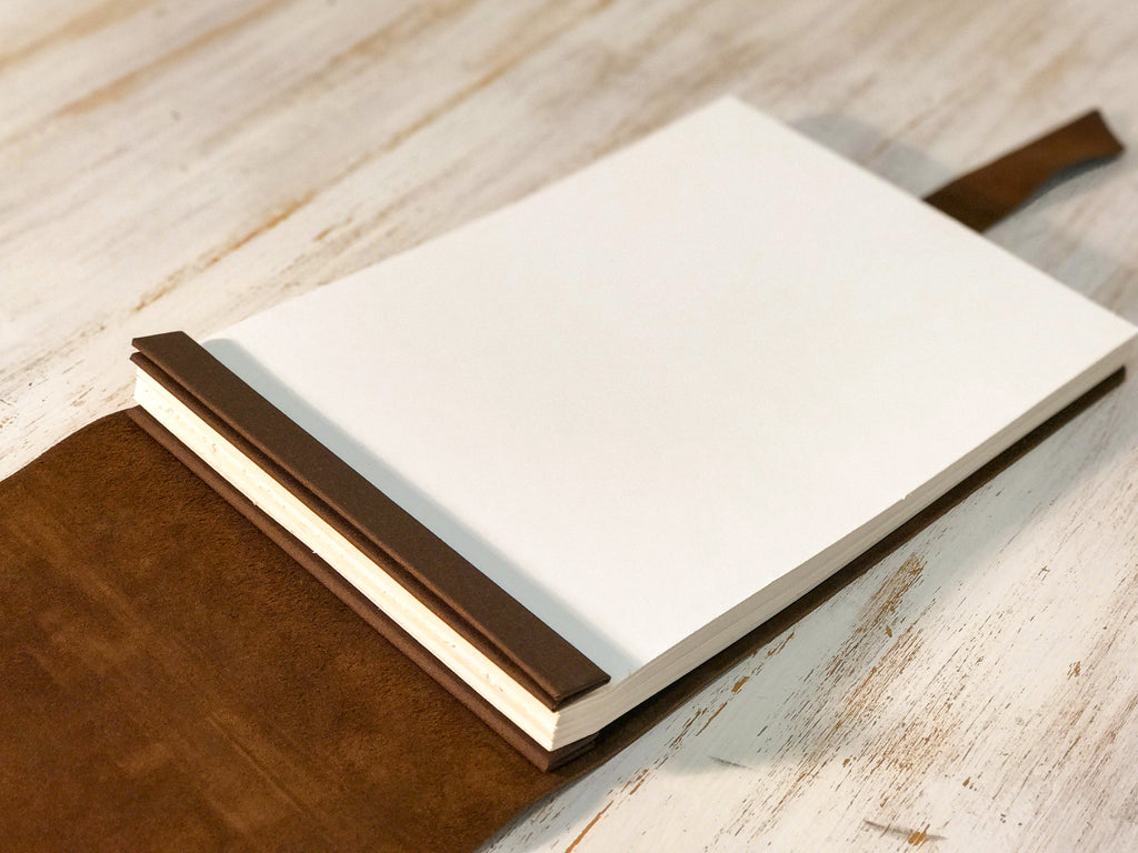 Leather book with blank A4 cartridge paper inserts for yacht SY Nilaya