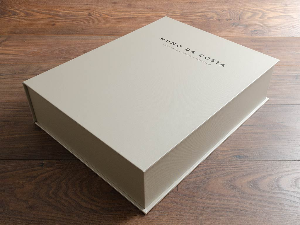 clamshell portfolio box in ivory buckram with black personalised lettering