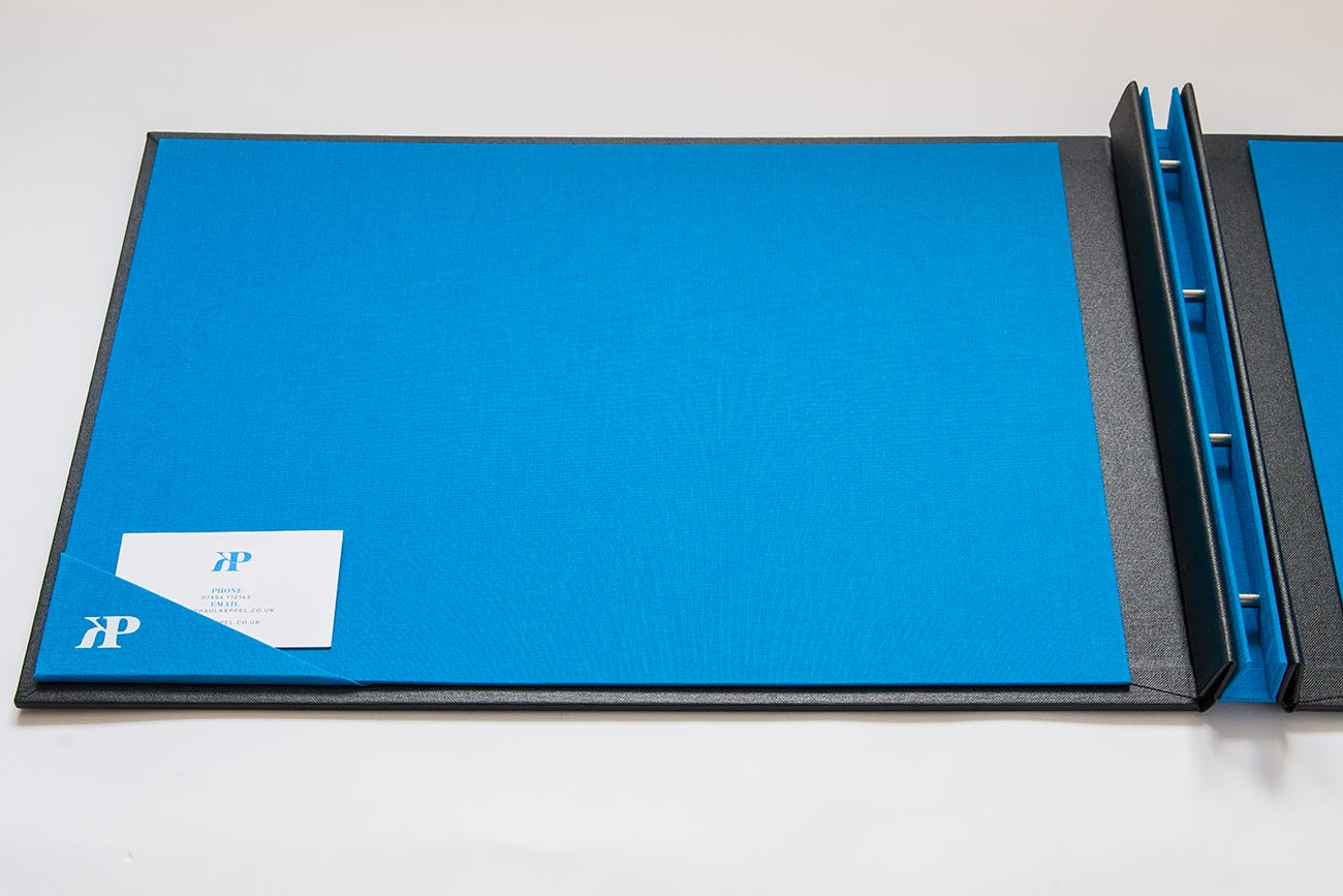 Business card pocket in custom H&Co portfolio - Brilliant blue book cloth with white foiling