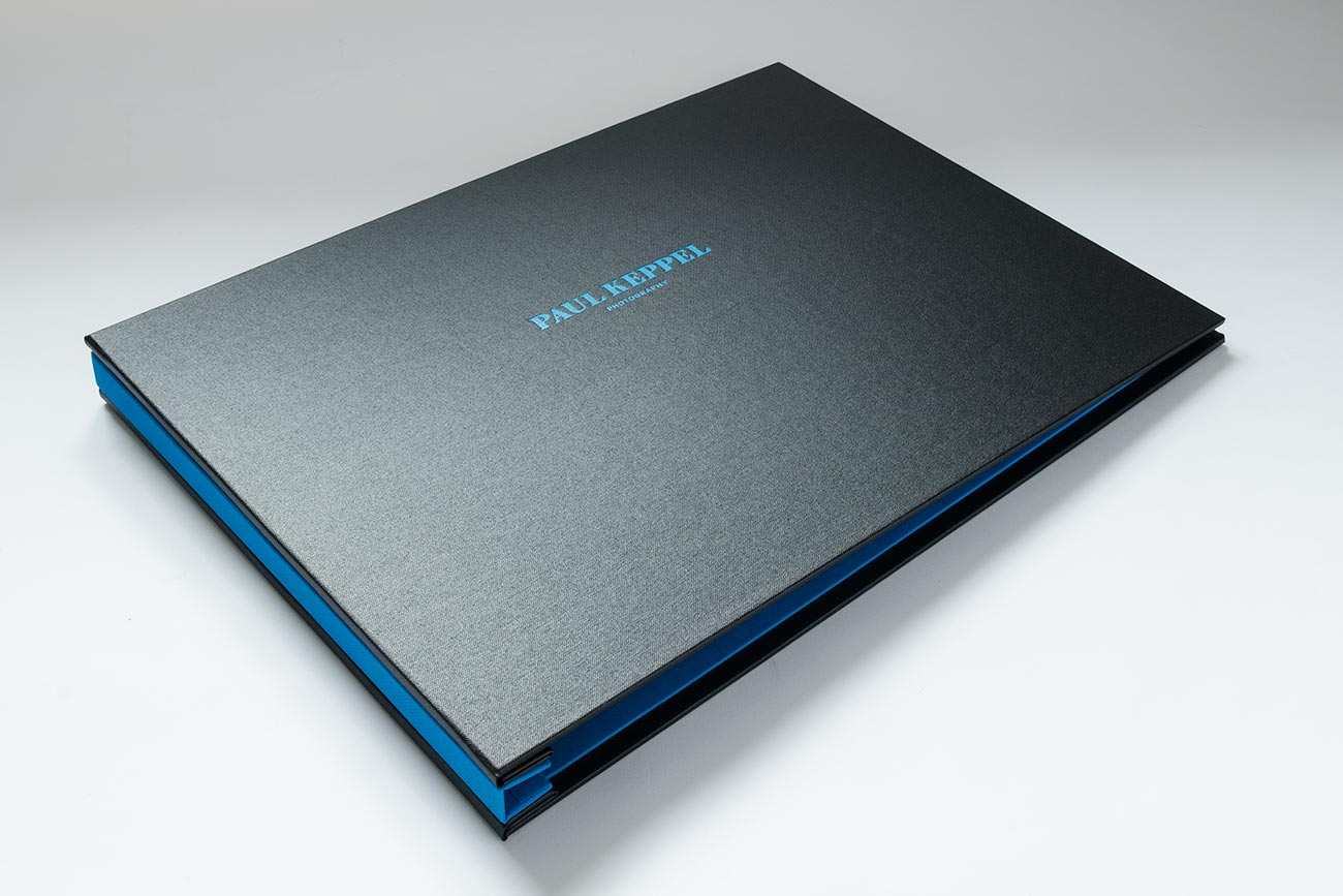 A3 landscape custom photographers presentation portfolio book - Black buckram cover with brilliant book cloth inner cover and blue foil personalisation