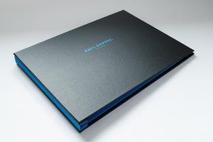 a3 landscape portfolio book with charcoal cover and blue personalised name on cover