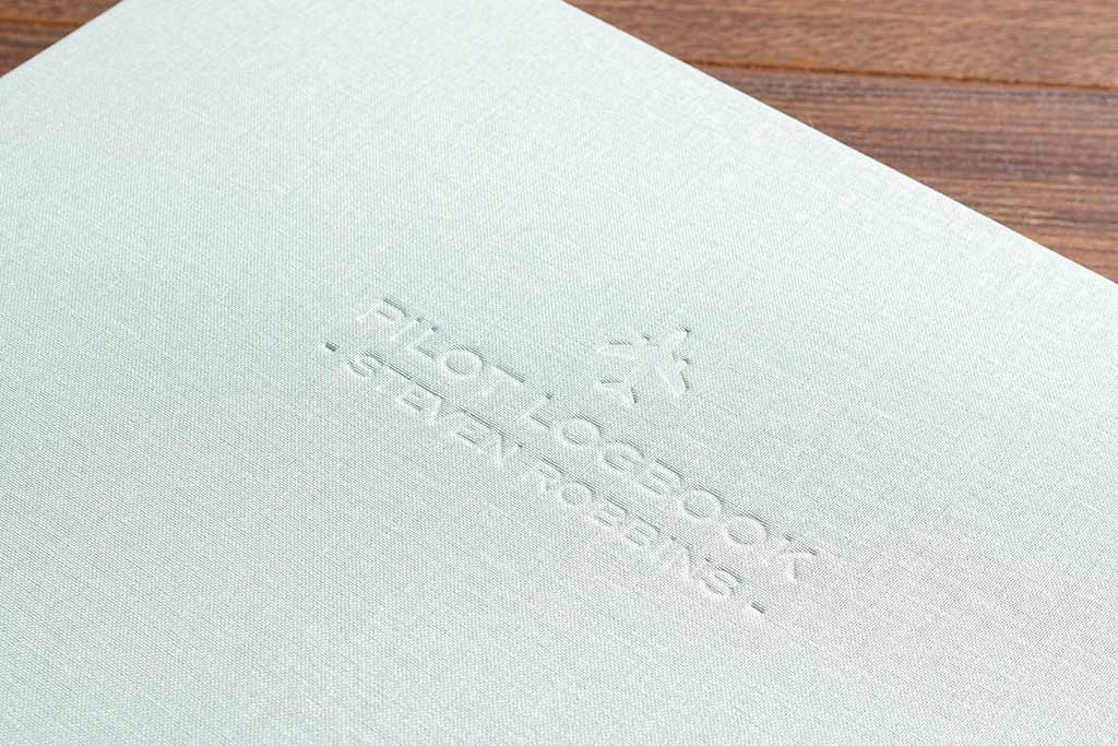 personalised blind embossing on the cover of a custom made pilots logbook