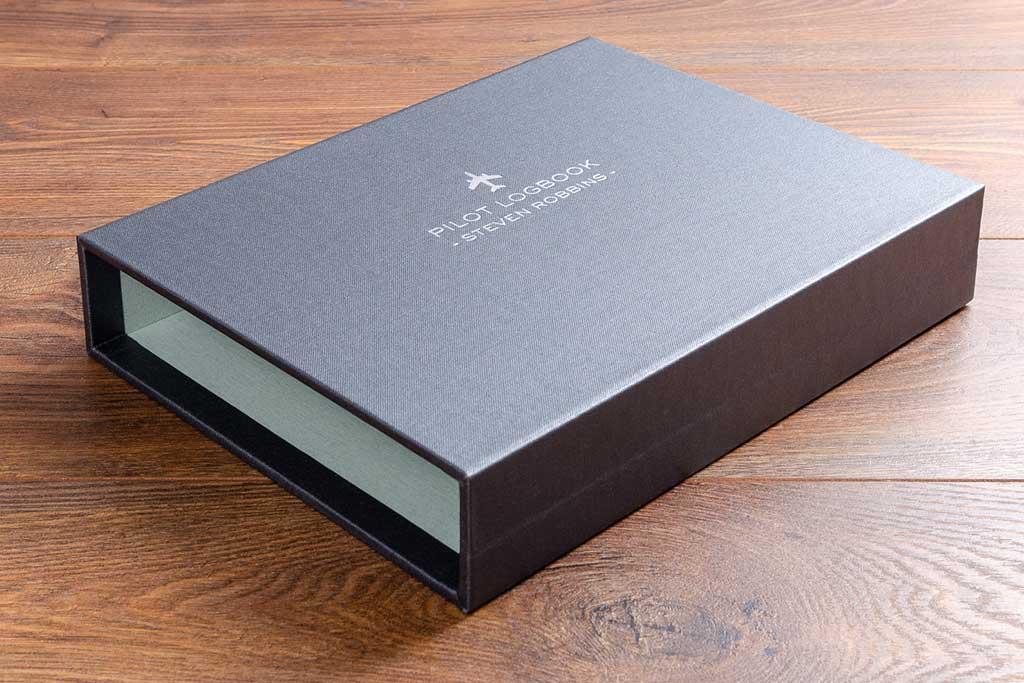 personalised and lined slipcase cover for logbook in pewter buckram