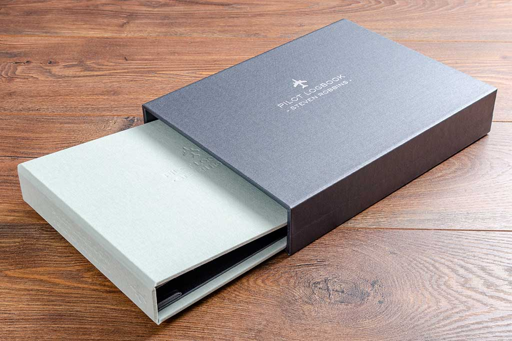 Pilots log book in lichen green and slipcase in pewter buckram