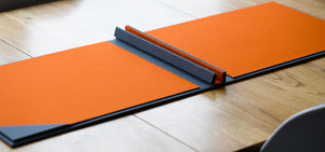screw post portfolio book in orange and grey fabric for photographers designers and architects