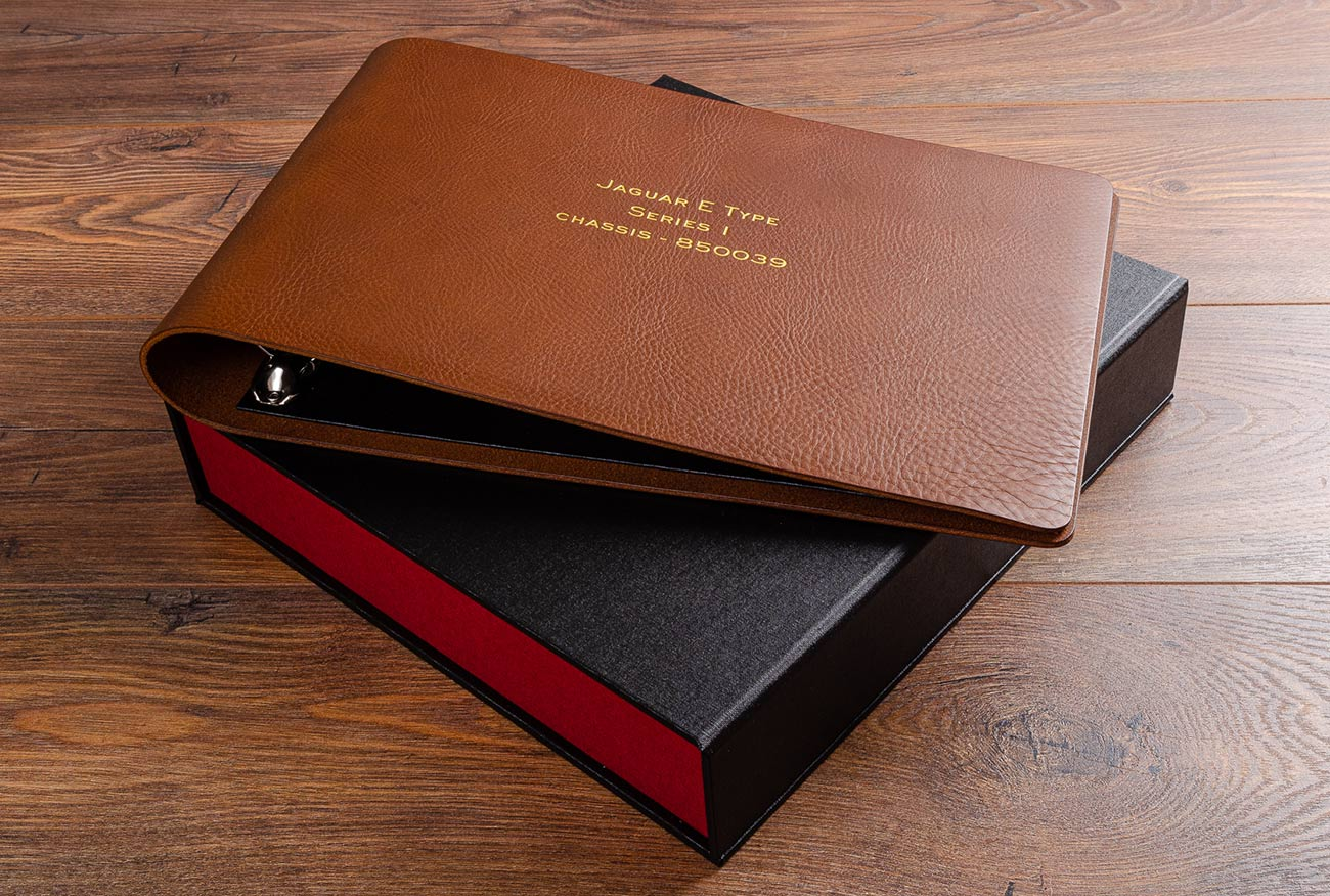 Leather album for restoration photographs with gold foil embossing and box file for documents
