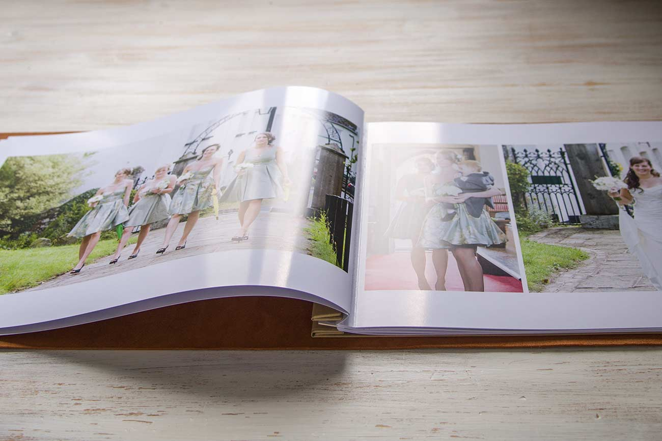 wedding photographs printed on a3 landscape paper then inserted into leather wedding album