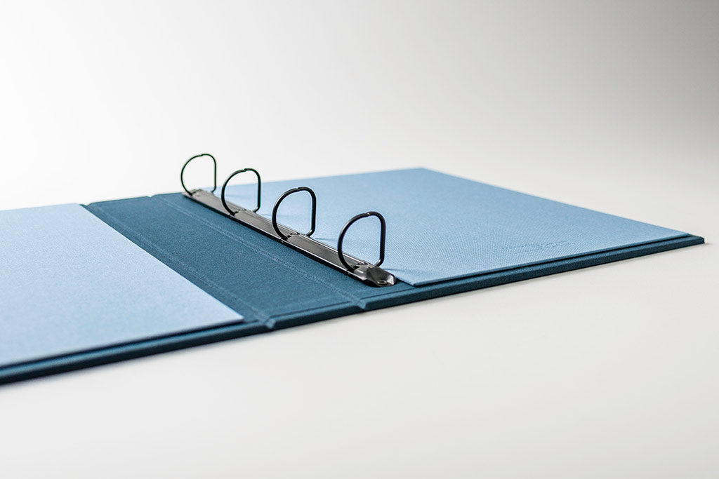 Ring binder with 2.5cm black D ring mechanism and deal blue book cloth