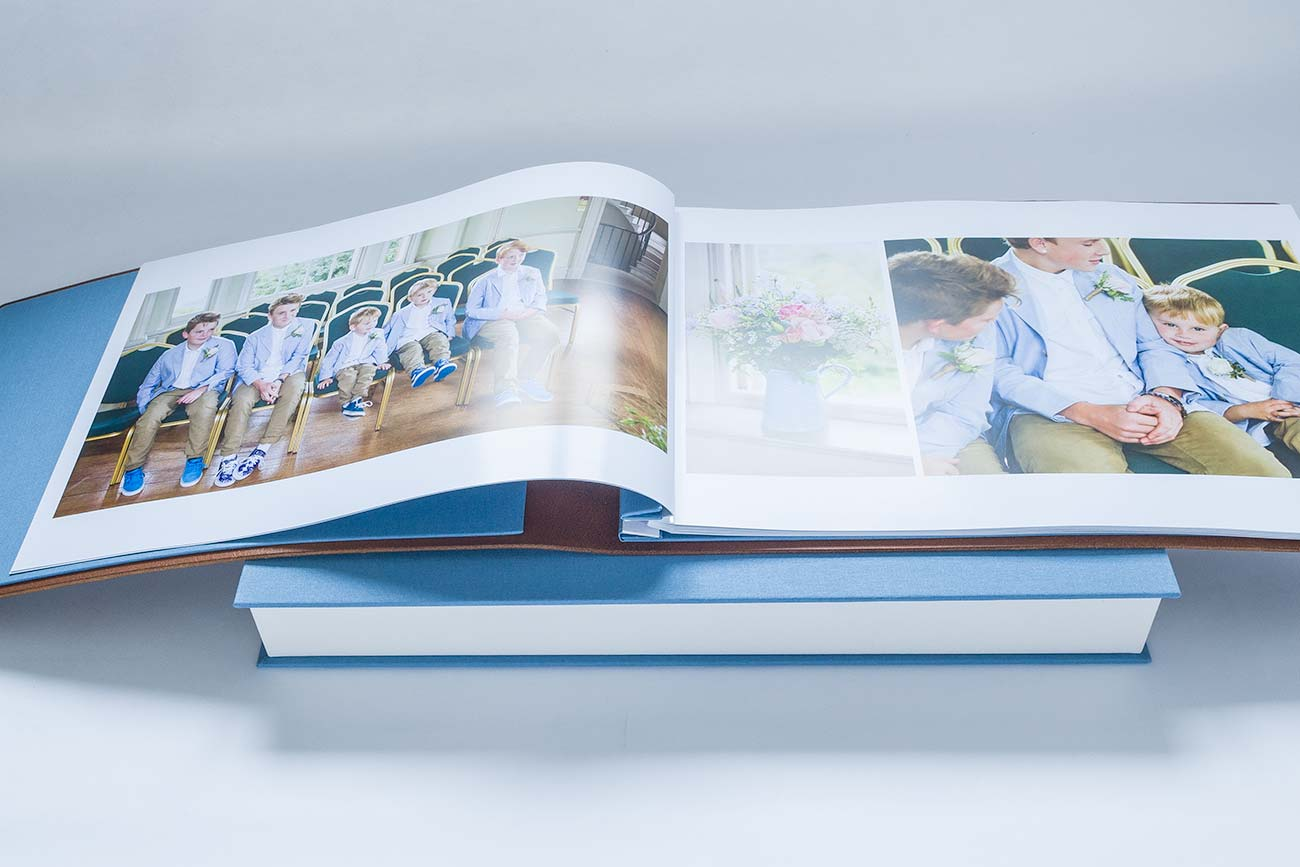 printed photo pages inserted into screw post wedding album suing H&Co hinge strips
