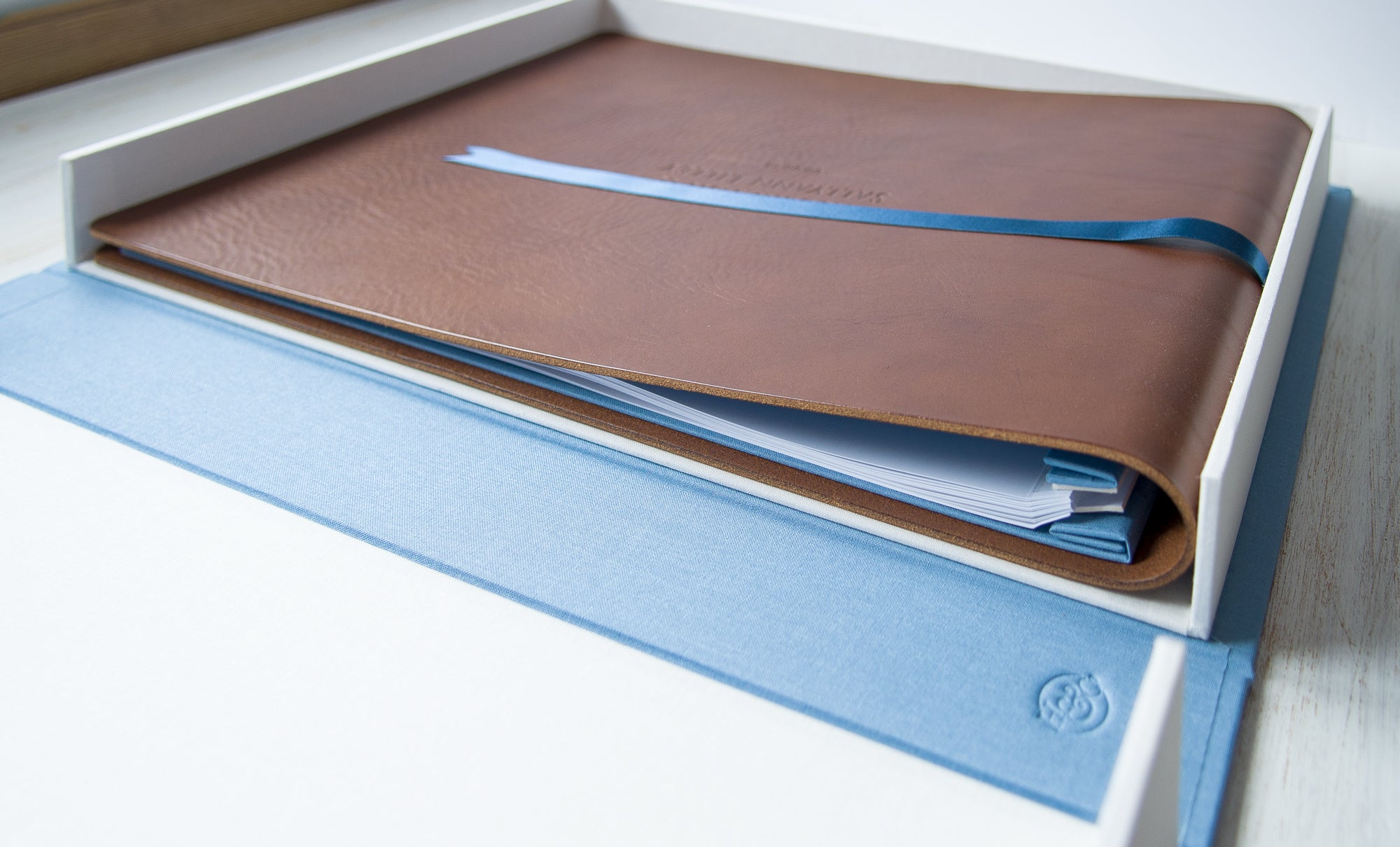 A3 leather wedding album sitting in A3 Clamshell Box