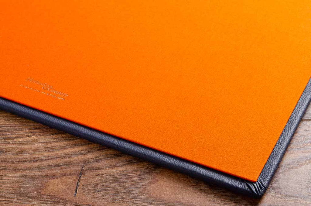 Solo orange inner cover with detail of blue leather outer cover