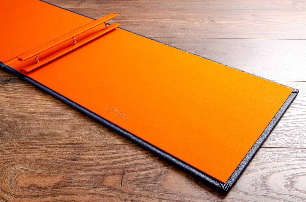 Portfolio book with 3 screw posts for binders and an inner cover in solo orange