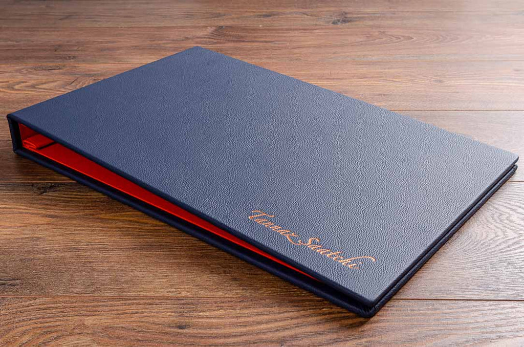 11x17 landscape format photography portfolio book in blue leather and rose gold foil embossed personalisation