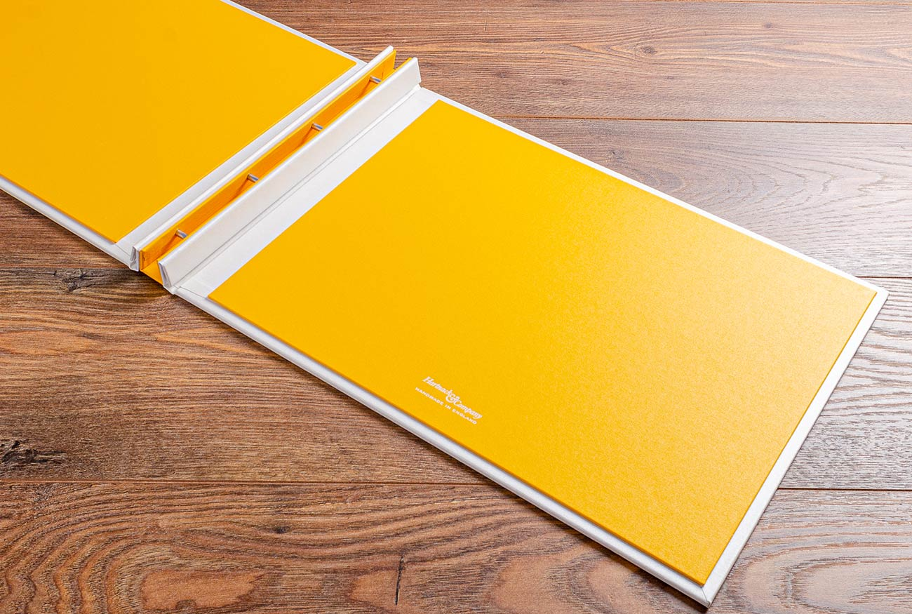 Hidden screw post portfolio book with a yellow buckram inner cover