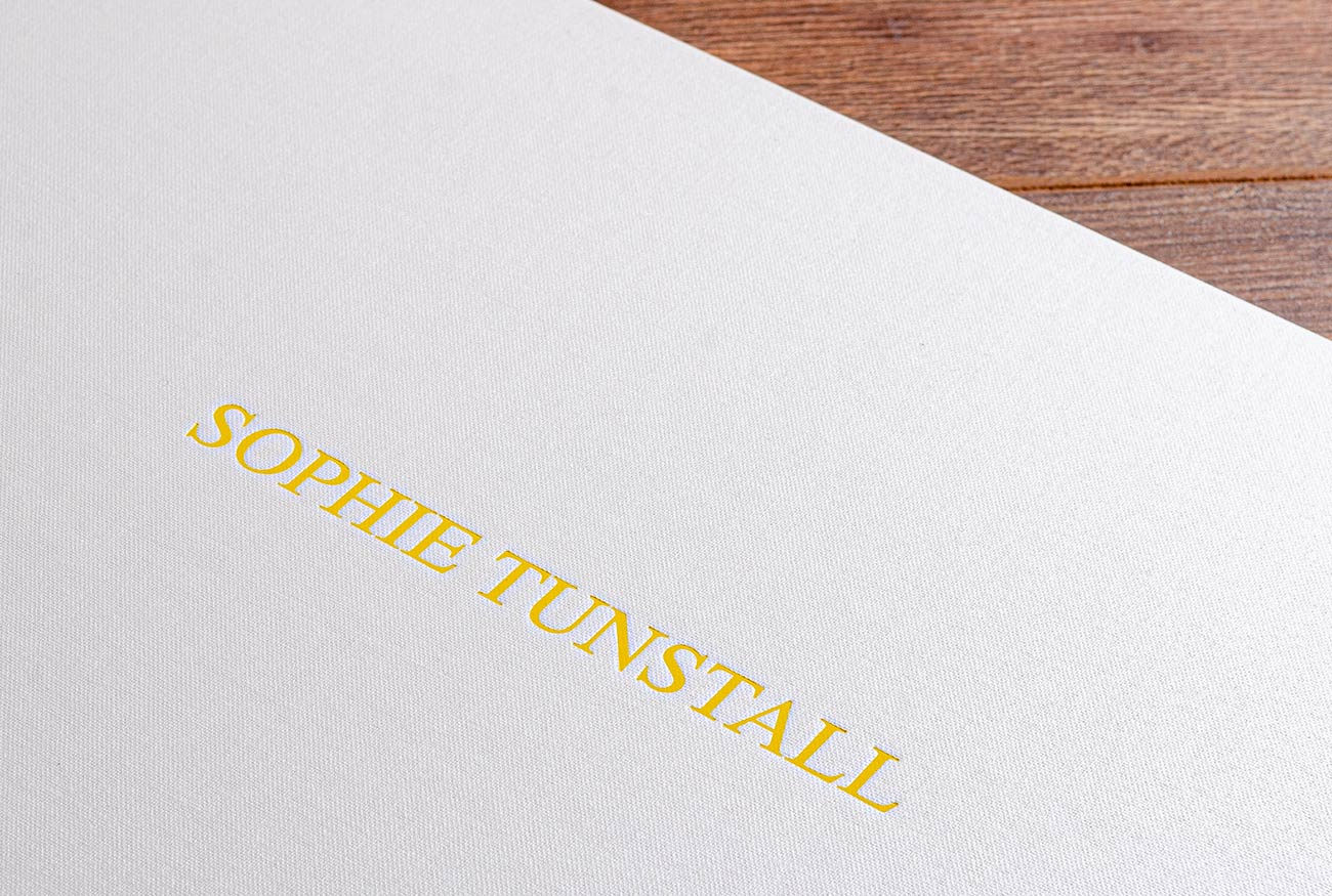 Yellow foil personalisation on a portfolio cover