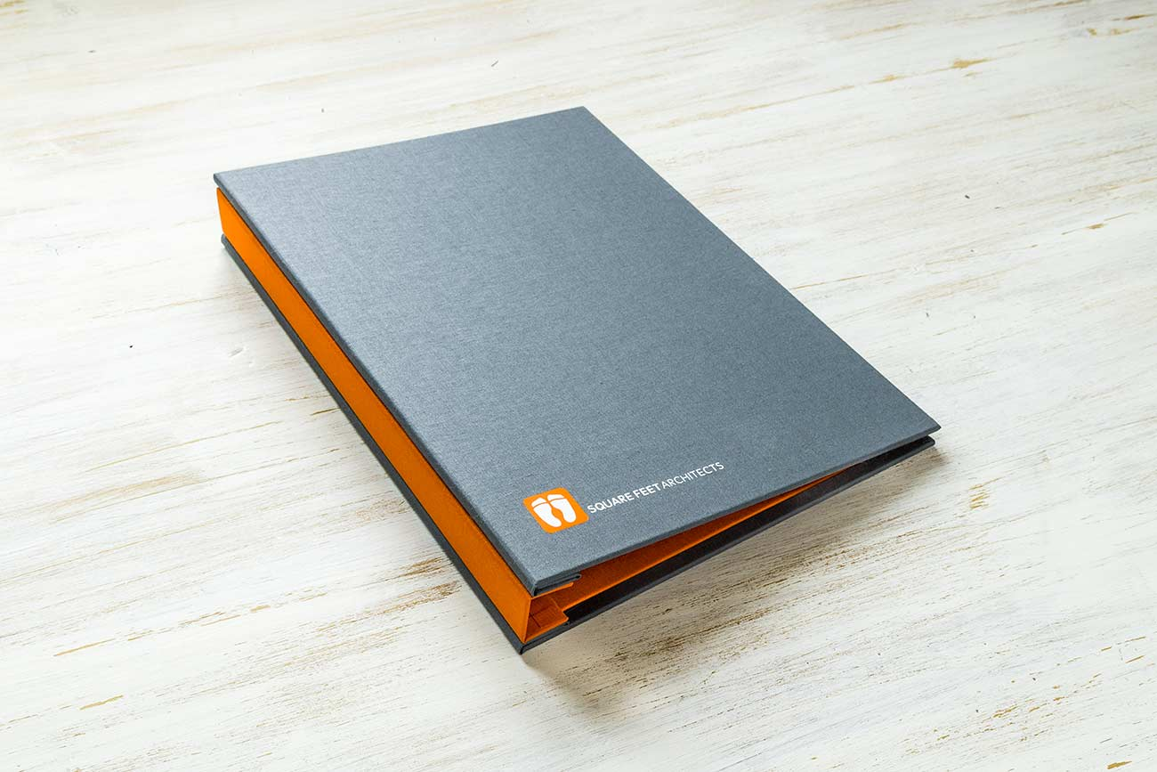 A4 custom hidden screw post portfolio binder - Plate grey book cloth cover and solo orange inner cover and 2 foil personalisation