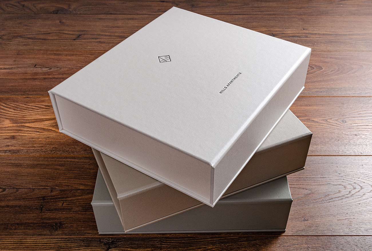 A set of three box binders for NZ property developers in pearl, beige and silver buckram
