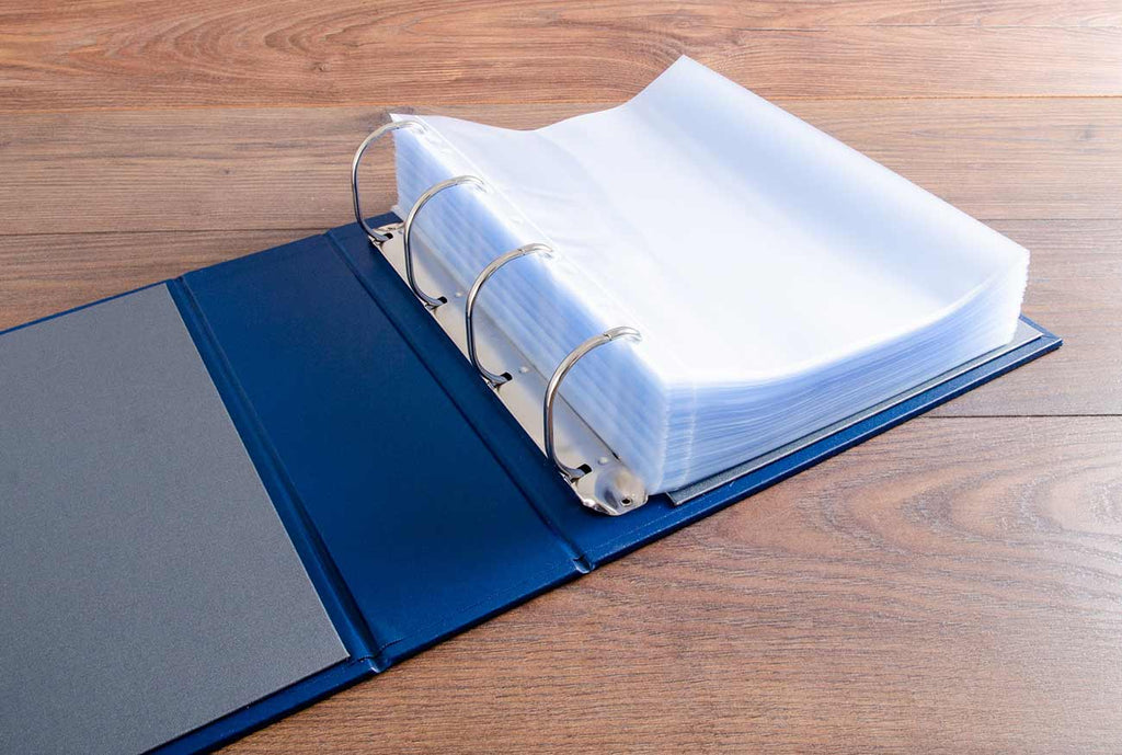 Large 6.5cm ring binder with 150 page protectors