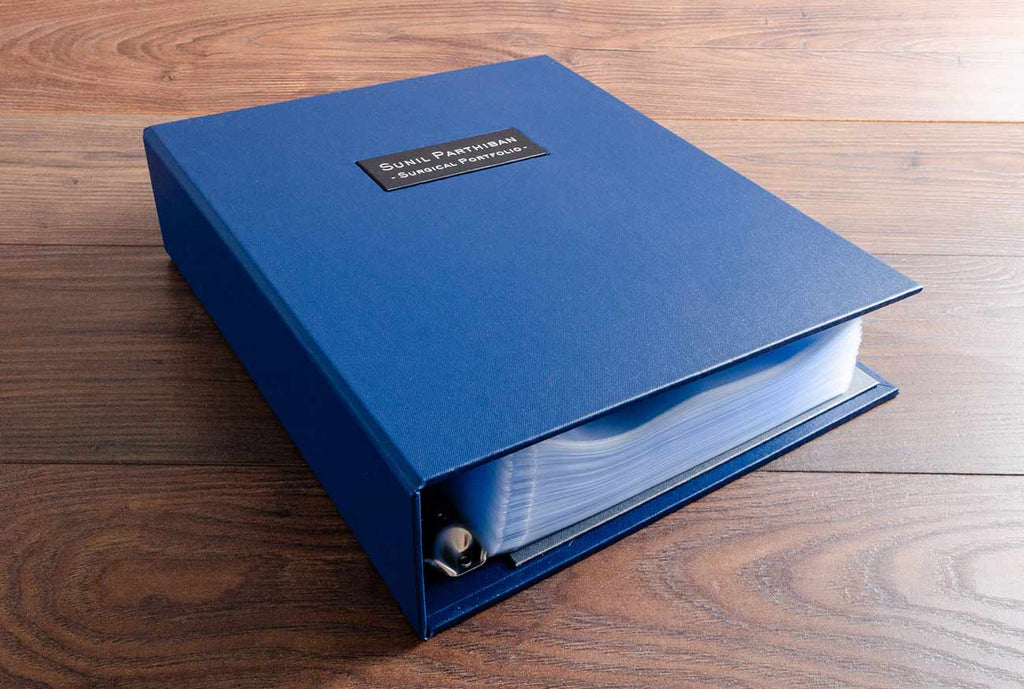 A4 Ring binder in Evening blue buckram and name plaque in black buckram with matt silver foiling