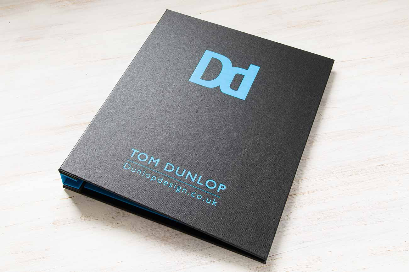 Custom Graphic Designers Portfolio Book - Charcoal outer cover, blue foil personalisation and brilliant blue inner cover and spine cover