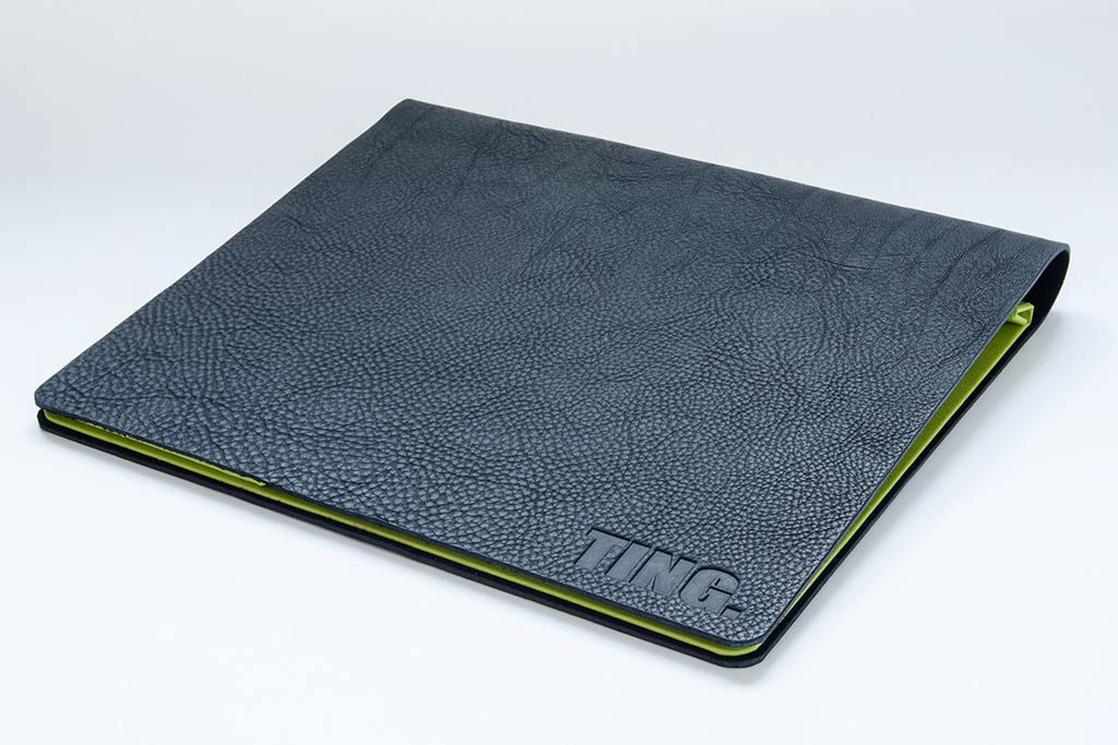 Black 2.5mm leather flip over portfolio with blind debossed logo and soon green inner cover