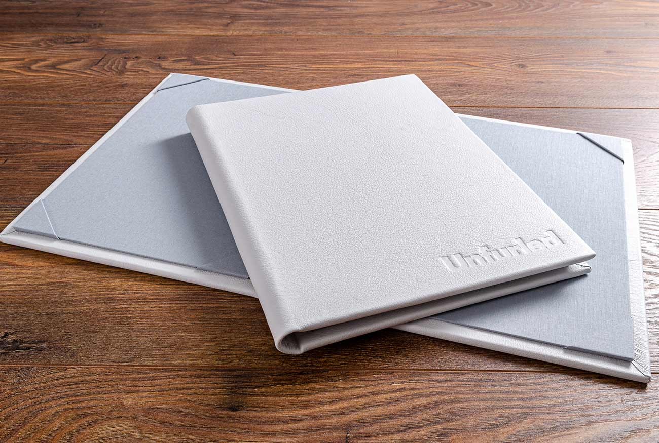 A4 white leather menus for super yacht SY Unfurled