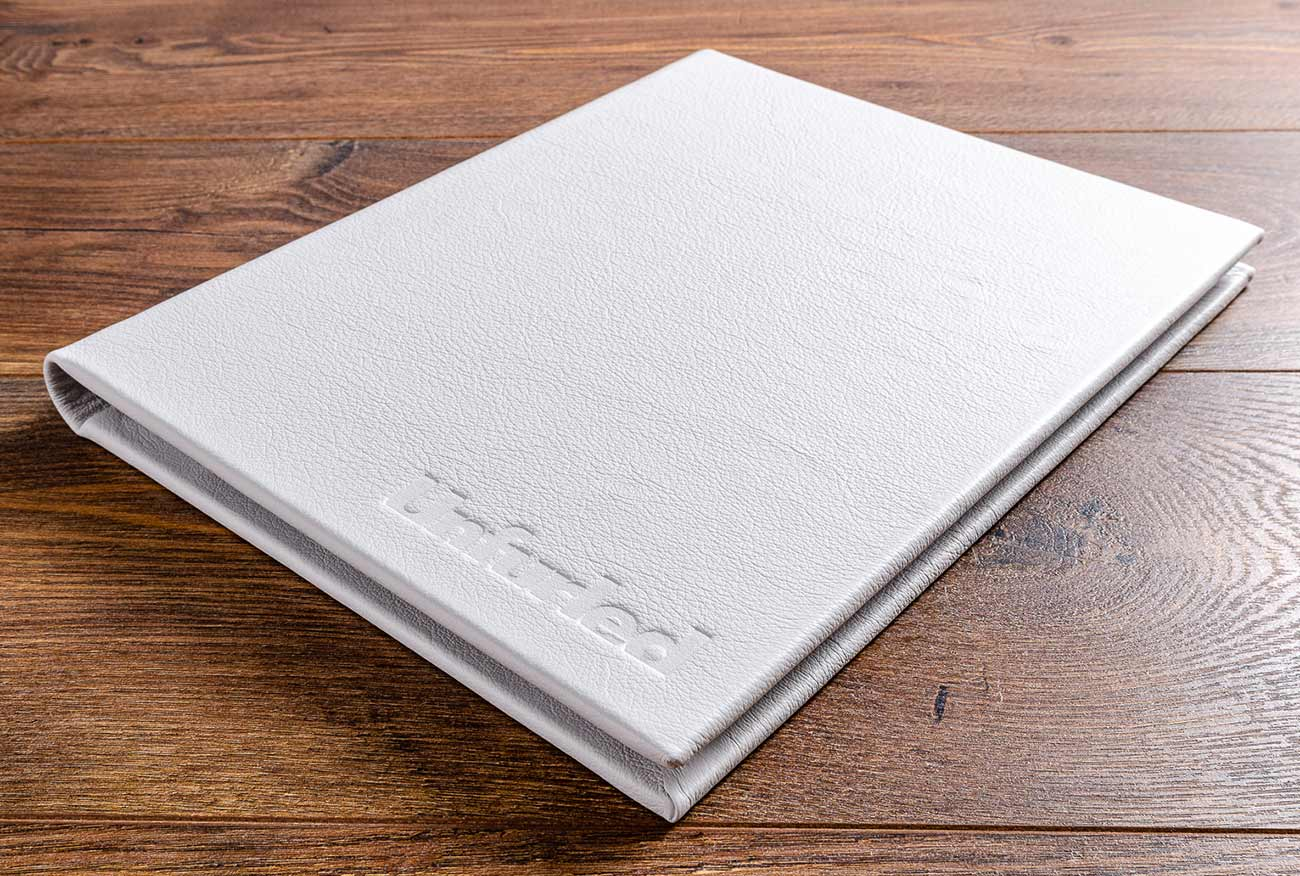 The white leather menus are covered in genuine leather and are blind bebossed on the cover